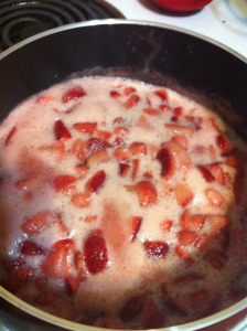 strawberries in a frothing pink liquid